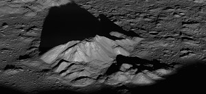 The central peak of Tycho crater, the Moon, protruding from the crater floor. Peak is 15 km across.